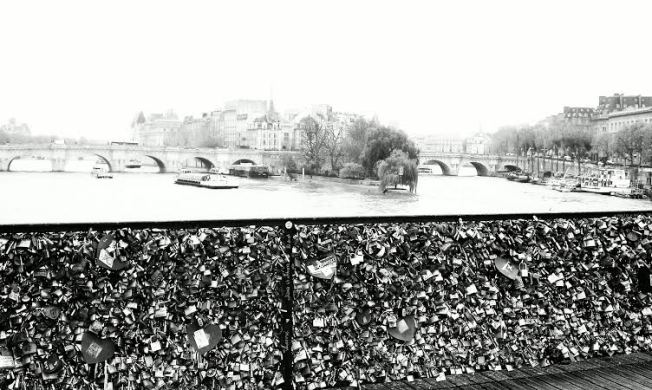 A view of Pont Neuf from the Love Lock encrusted Des Arts Bridge.