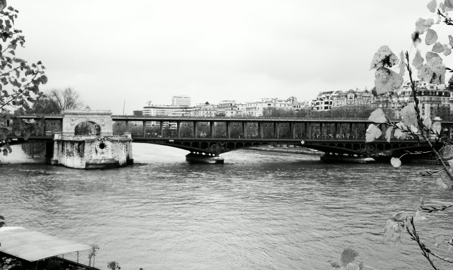 A two level bridge - one for pedestrians and the other for vehicles.